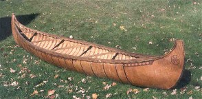 old-form  high ended Algonquin Indian birchbark canoe; this style inspired the high rounded ends of the French Fur Trade birchbark canoes and pre-dates the more modern Wabanaki style of the late 19th and early 20th centuries