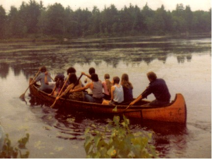24' Fur-Trade era birchbark canoe built in 1974 by Vaillancourt in the style of the Algonquin of northwestern Quebec ; shown with 11 people on board and a draft of 8''