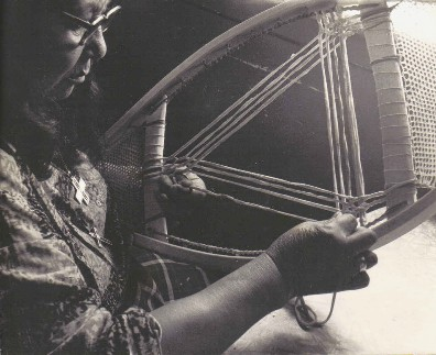 Elisabeth Flamand weaving the mid-section of a pair of square-toe snowshoes ; Manoune , Quebec 1979 ; photo Henri Vaillancourt