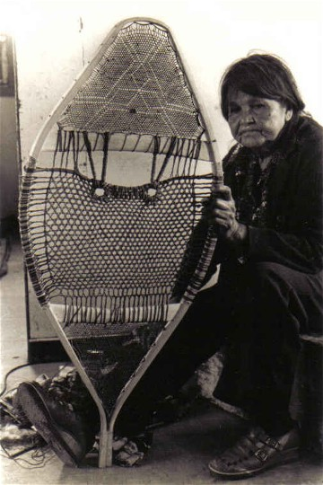 lizabeth holding snowshoe with detailed woven design