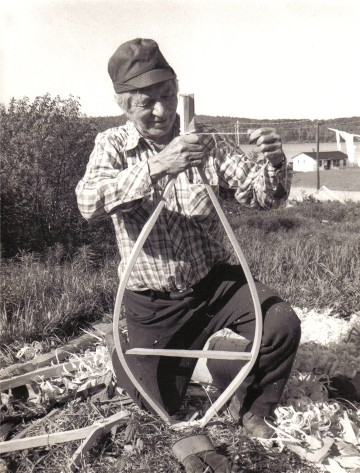 Moise Flamand tying the tails of a newly bent snowshoe frame ; the frames are usually corrected in shape later and then tied together to dry evenly , Manouane Quebec 1979 ; from ''Making the Attikamek Snowshoe'' ; photo Henri Vaillancourt