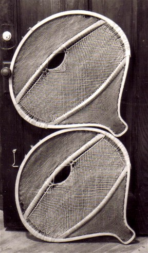 Old Montagnais beavertail snowshoes of an extremely  wide pattern in the Chateau de Ramezay in Montreal . Some snowshoes of this type are even wider than this pair, having widths that exceed the length by as much as 1 1/2 '' ; photo Henri Vaillancourt  1973