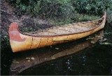 A 1/2 scale model of a 24' Fur-Trade type birch bark canoe . This style with an upright stem profile was formerly built by the Algonquin of western Quebec.
