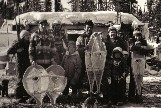 Mistassini Cree family in front of their winter hunting camp with ''beavertail '' and ''pointed -toe'' snowshoes. photo- Henri Vaillancourt 1979