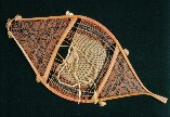 A very fine example of Attikamek Indian snowshoe, circa early 1900's . The end sections are woven with complex geometric patterns and the midsection features the fancy ''double selvage cords'' ; from ''Making the Attikamek Snowshoe'' ; photo -courtesy of Lower Fort. Garry National Historic Park