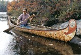 18 foot Fur-Trade style birch bark canoe with typical painted  decoration and fancy root sewng on bows . This type  of bark canoe was built from the 1600's to the early 1900's  by both Indian and French craftsmen for Canadian government and military purposes ,as well as  for the fur-trade
