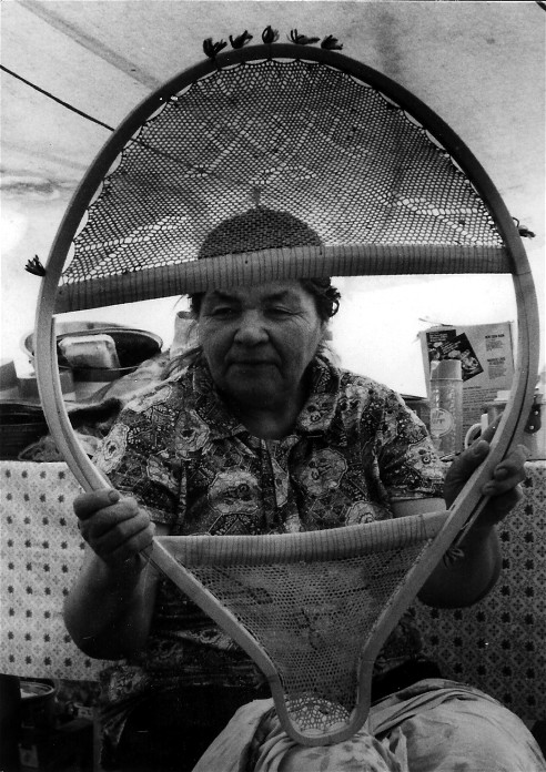 Mistassini Cree beavertail snowshoes laced with caribou skin and ornamented with the woven geometric designs once common in the eastern woodlands ; yarn tufts ornament the birch wood frame ; from the video ''Beavertail Snowshoes''; photo Henri Vaillancourt 1977